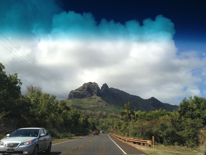 Anahola Hawaii Transportation Car Sky Motor Vehicle Mode Of Transportation Tree Cloud - Sky Mountain Day No People City Direction Nature Street The Way Forward Outdoors Beauty In Nature Plant Road Land Vehicle