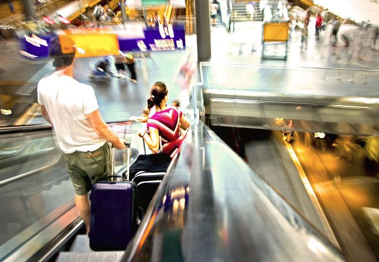 Rear View Of People On Escalator At Berlin Hauptbahnhof