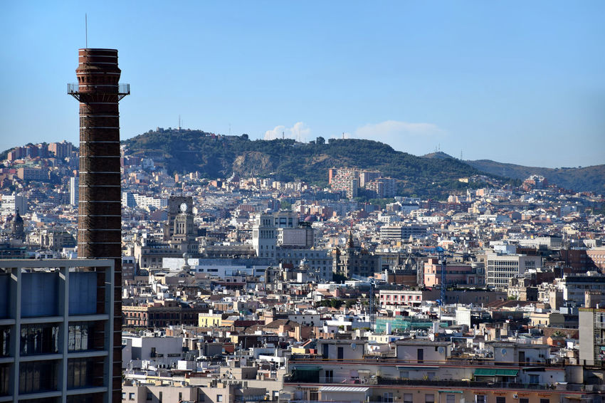 Chimney with Barcelona's cityscape on background, Barcelona Chimney Clear Sky Architecture Blue Building Building Exterior Built Structure City Cityscape Clear Sky Crowded Housing Outdoors Sky Travel Destinations