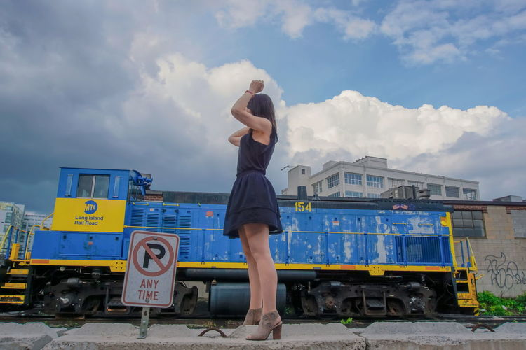 Train Train - Vehicle Train Station Industry Industrial NYC New York Outdoor Day Cloudy Sexygirl Beauty Beautiful Woman Fashion Legs Footwear Hair Young Women Full Length Arts Culture And Entertainment Women Fashion Blue Sky Cloud - Sky Mini Dress High Heels Voluptuous Seductive Women Complexion The Portraitist - 2019 EyeEm Awards My Best Photo