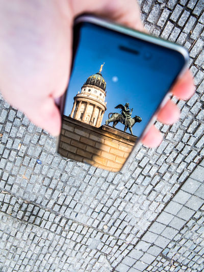 Reflection of berlin cathedral in smartphone