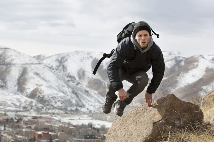 Jumping into adventure. Colorado Gold Mountains Snow Hiking Adventure Mountain One Person Cold Temperature Leisure Activity Winter Full Length Young Adult Nature Day Front View Mountain Range Rock Sport Sky Lifestyles Adult Outdoors Warm Clothing Jumping