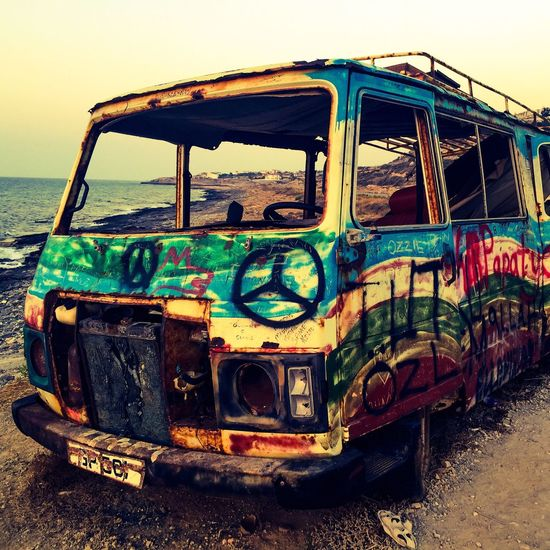 Transportation Mode Of Transport Land Vehicle Abandoned Travel Obsolete Outdoors Multi Colored Weathered Day Tourism