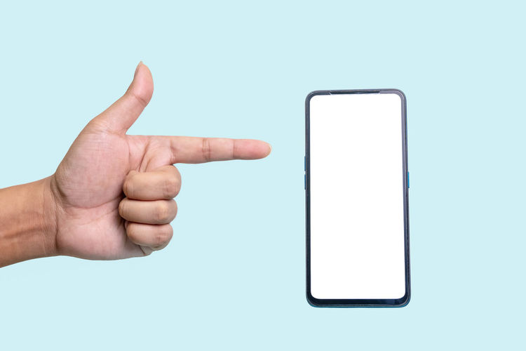 Midsection of person using smart phone against white background