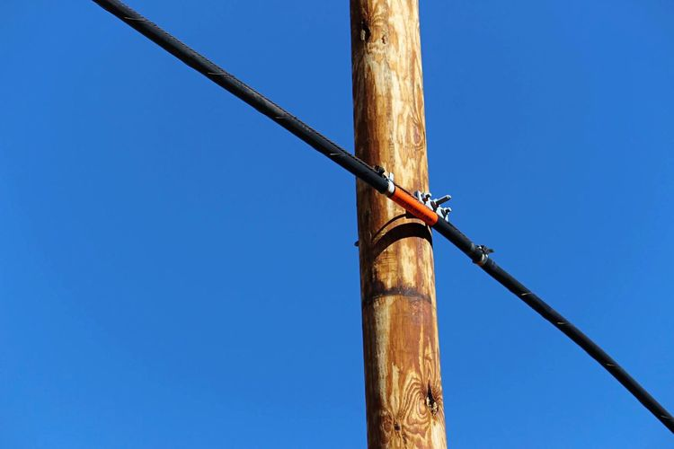 Power Line  Wood Pole Blue Clear Sky Low Angle View Outdoors No People Day Nature Sky