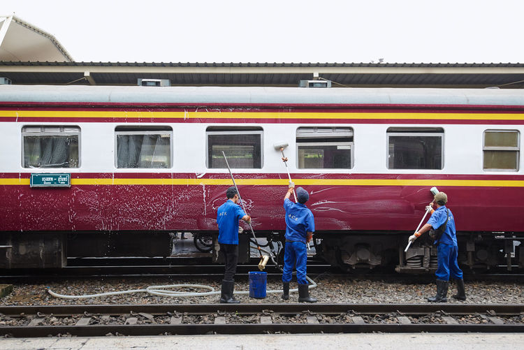 Transportation Public Transportation Rail Transportation Mode Of Transportation People Real People Day Architecture Group Of People Railroad Station Platform Track Railroad Track Train - Vehicle Men Train Standing Full Length Adult Land Vehicle Occupation Outdoors Warm Clothing