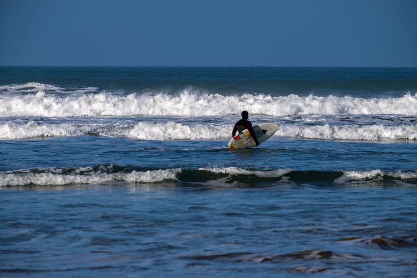 Surfer Woolacombe, Devon Adventure Aquatic Sport Beauty In Nature Day Extreme Sports Horizon Over Water Leisure Activity Lifestyles Motion Nature Ocean One Person Real People Scenics Sea Skill  Sport Surfboard Surfing Vacations Water Waterfront Wave