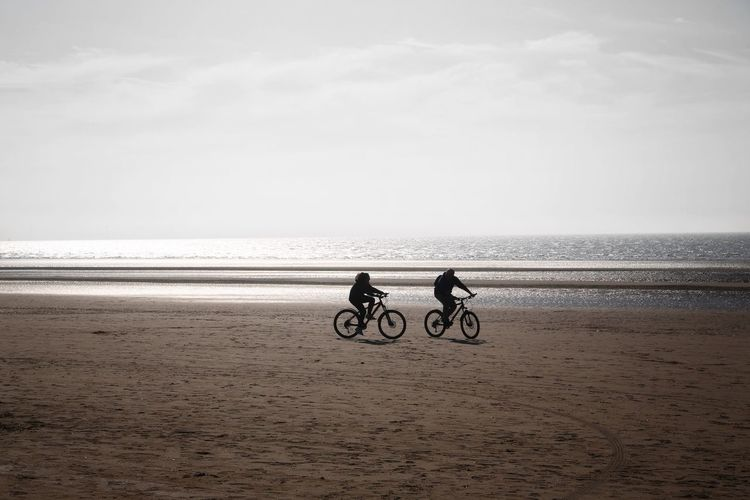 Formsby Beach Formsby Beach Liverpool Sea Sky Beach Land Water Two People Horizon Over Water Horizon Scenics - Nature Sand Nature Beauty In Nature Real People Leisure Activity Men People Bicycle Land Vehicle Transportation Riding Outdoors