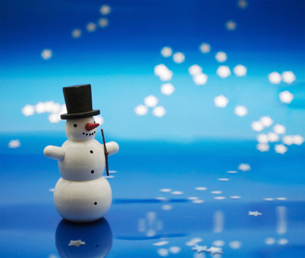 Close-Up Of Snowman Figurine On Table