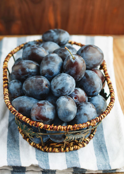 High Angle View Of Blueberries In Basket On Table