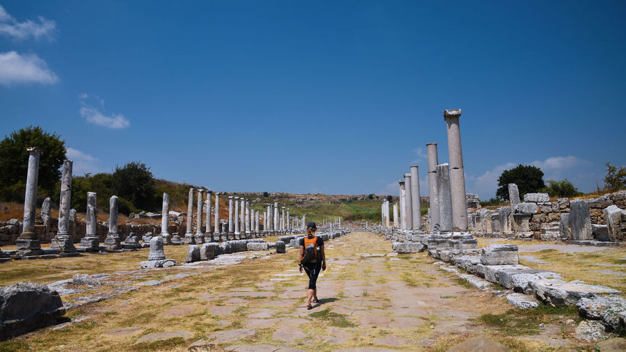 Perge, Turkey Antalya Perge Turkey Woman Adult Ancient Ancient Civilization Archaeology Architectural Column Architecture History Old Ruin One Person Outdoors People Portrait Real People Sky Connected By Travel EyeEmNewHere Lost In The Landscape