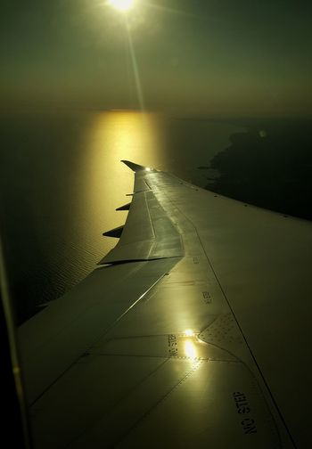 Wet Sunset No People Water Sky Baleric Sea Sunset_collection Sea Travel Destinations Horizon Over Water Vacations Clear Sky Plane Plane Wing Airplane Flying Sun Reflection