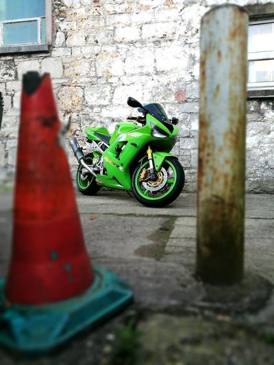 Motor Bike, Race Bike Green Color No People Outdoors Close-up Day Road Race Speed Fast Accelerator Acceleration Rubber Pedal Metal Bhp Speedometer Break Disk Exhaust Transport Helmet Leather Gloves Traffic Cone Gold Green Carcbon Fibre 0-60
