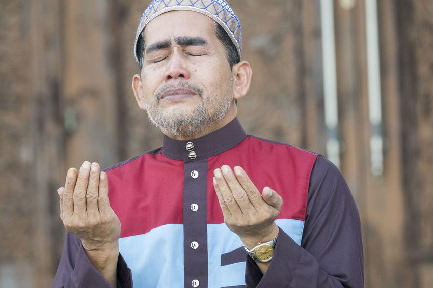 Middle age muslim man praying at mosque. Eid Mubarak Muslims One Person Only Ramadan Mubarak Deeds Devotees Islam Islamic Mosque Muslim One Person Praying Wholeheartedly