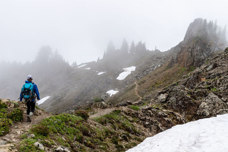 Man standing on mountain during winter
