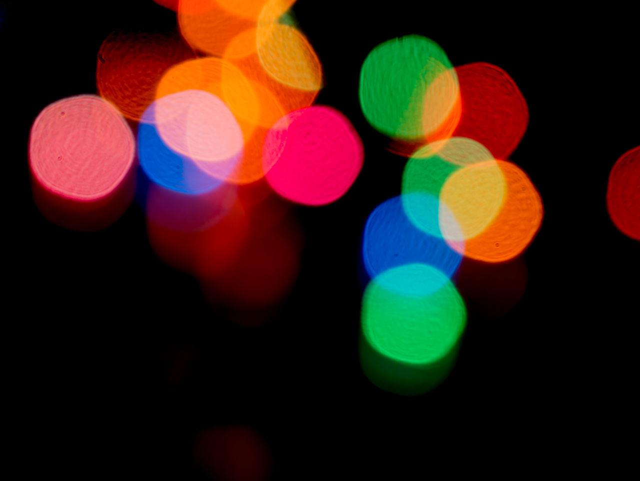 illuminated, lighting equipment, multi colored, night, black background, light effect, colorful, no people, defocused, studio shot, celebration, projection equipment, close-up, disco lights, outdoors