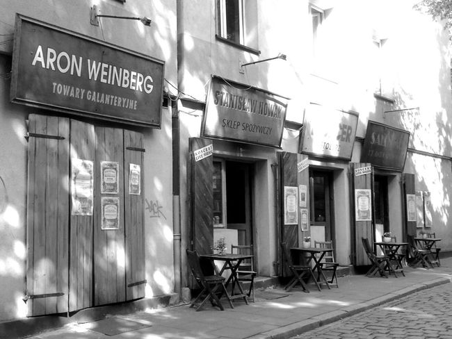 Old shops. Street photo from Cracow. Creative Light And Shadow Black And White Photography Black And White Collection  Streetphotography Streetphoto_bw The EyeEm Facebook Cover Challenge