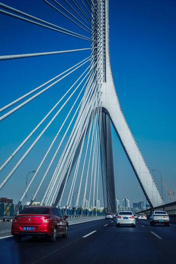 桥来桥上过,脚打脚下消,是非权一笑,百练任徒劳。 bridge Transportation Motor Vehicle Car Bridge Connection Bridge - Man Made Structure Mode Of Transportation Land Vehicle Sky Road