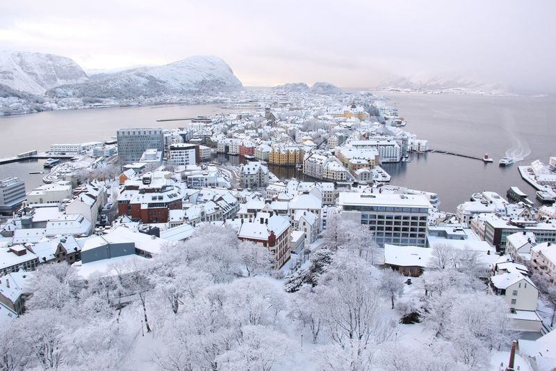 Winter in Ålesund Arctic Ålesund, Norway Norway EyeEm Selects Winter Snow Water Cold Temperature Scenics - Nature Beauty In Nature Mountain Building Exterior Sea High Angle View Ice Mode Of Transportation Transportation No People Architecture Sky Frozen Outdoors Day Nature