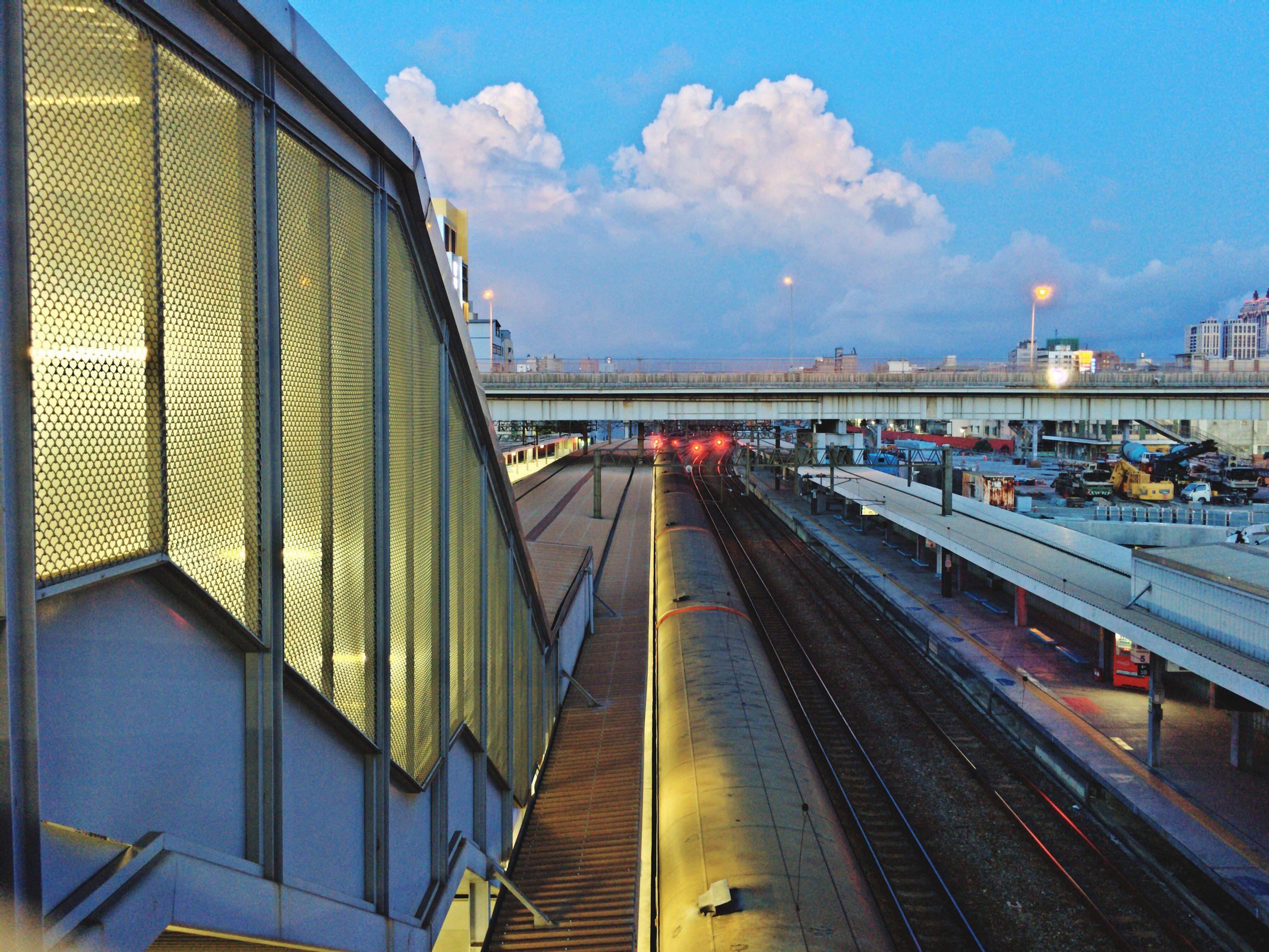 transportation, sky, rail transportation, railroad track, public transportation, mode of transport, built structure, train - vehicle, cloud - sky, architecture, no people, outdoors, day, building exterior