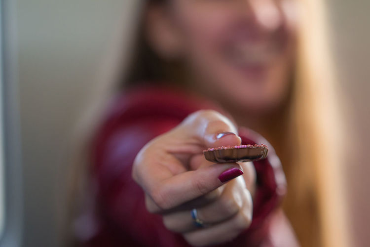 Close-up of woman holding cookie