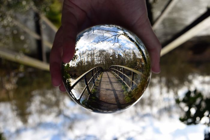 The upside down EyeEmNewHere Landscape View Perspective Crystalball Crystal Upsidedown Manipulated Manipulation Human Hand Real People Reflection Focus On Foreground Close-up Outdoors Day