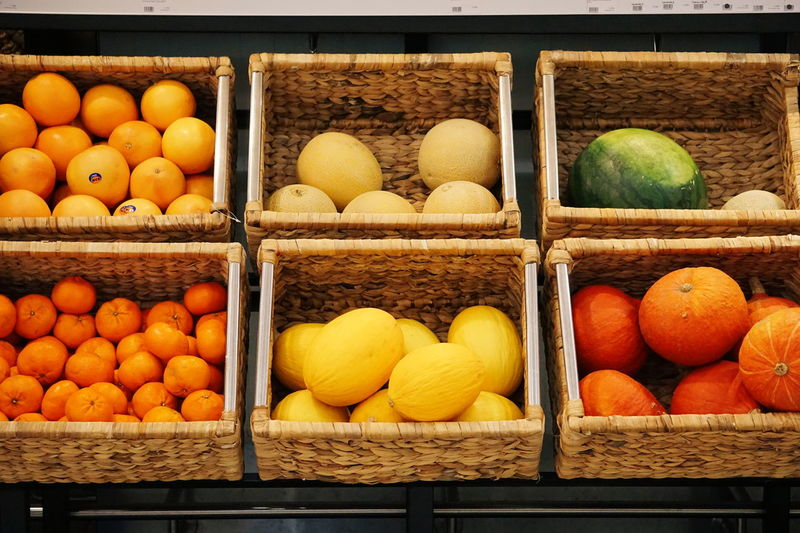 Various fruits and vegetables in basket at market stall