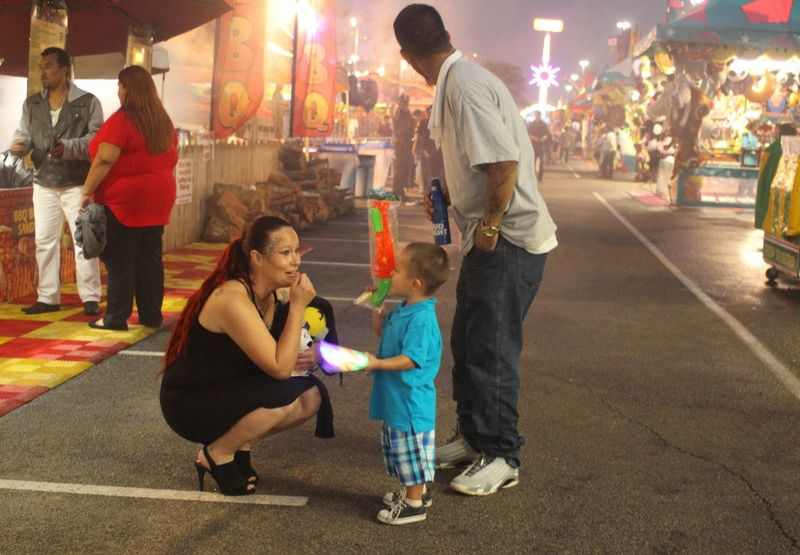 Family time till the mist rolls in. Carnival Fiesta Satx Family Telling Stories Differently