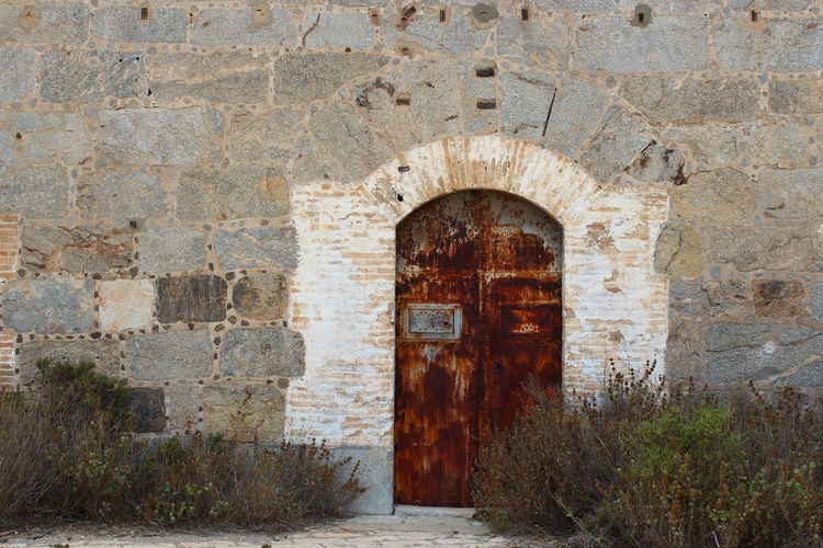 Abandoned Arch Architecture Brick Brick Wall Building Building Exterior Built Structure Closed Day Deterioration Door Entrance History No People Old Outdoors Ruined Solid Stone Wall The Past Wall Wall - Building Feature Weathered