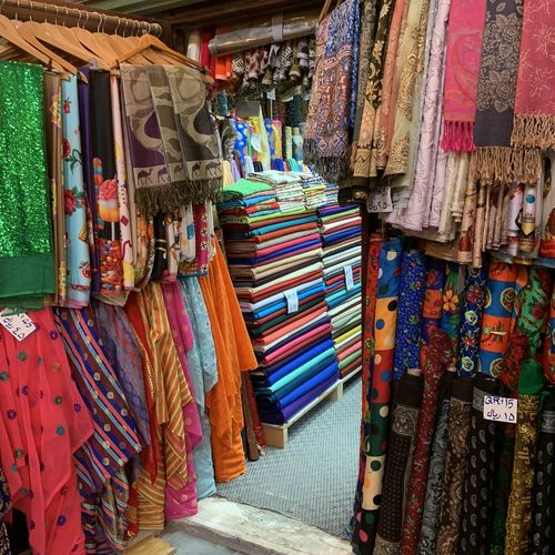 Colorful shawls hanging for sale