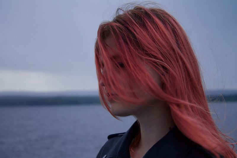 Young woman with redhead at sea