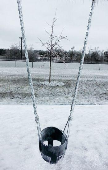 Early Spring Encased In Ice Baby Swing  Freezing Rain Park