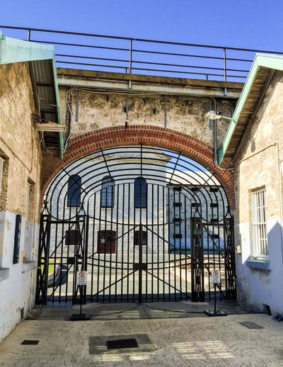Entrance Gate: Fremantle Prison Entrance Exterior Brick Tourist Attraction  Old Building Limestone Architecture Historic Historical Building Prison Fremantle Prison Fremantle, Western Australia Gate Entrance Gate Metal Large Gated  Gateway