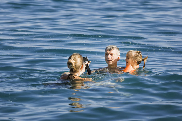 Family enjoying in sea