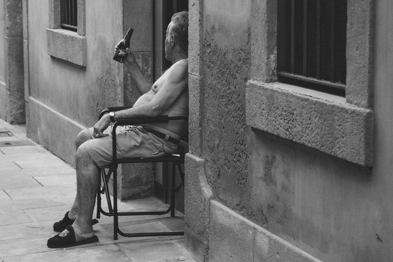 Architecture Blackandwhite Building Exterior Built Structure Casual Clothing Day Domestic Animals Domestic Cat Façade Full Length Homelessness  Outdoors People And Places Person Pets Relaxation Resting Sitting Steps Weathered