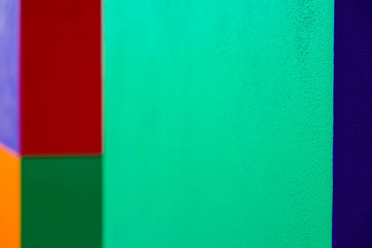 Abstract geometric pattern on concrete wall Abstract Architecture Backgrounds Blue Built Structure Close-up Copy Space Full Frame Green Color Indoors  Material Multi Colored No People Pattern Red Studio Shot Textured  Variation Vibrant Color Wall - Building Feature