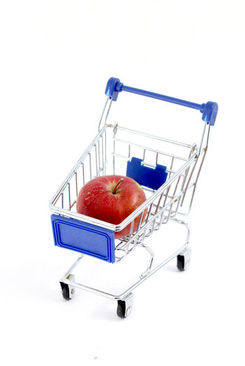 Apple Apple - Fruit Basket Close-up Consumerism Day Food Food And Drink Freshness Fruit Groceries Healthy Eating No People Red Retail  Shopping Basket Shopping Cart Studio Shot Supermarket Trolley White Background
