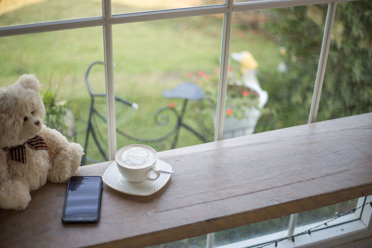Teddy Bear at Coffee Shop Animal Animal Themes Coffee Cup Cup Day Domestic Animals Drink Food And Drink Glass - Material Indoors  Mammal Mug No People Pets Seat Stuffed Toy Table Tea Cup Teapot Teddy Bear Transparent Window