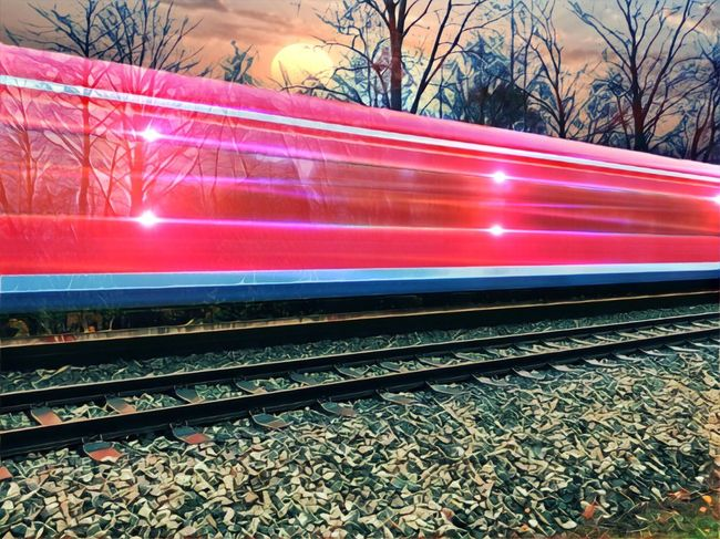 Transportation Railroad Track Rail Transportation Speed Public Transportation Train - Vehicle Mode Of Transport Blurred Motion Railroad Station Platform Motion Railroad Station Bare Tree Station Night Outdoors Illuminated Tree No People Sky Landscape Sunset Creative Light And Shadow