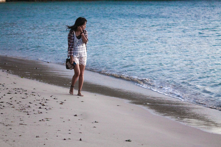 Sand Beach Sea Water One Person Full Length Vacations Only Women Summer Walking Adults Only Adult Day People Wave Fun Leisure Activity Outdoors One Woman Only Women Walking On The Beach Alone Longing Lonely Traveller Long Goodbye TCPM