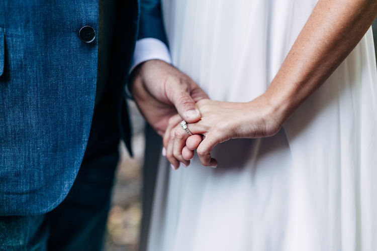 Two People Human Hand Couple - Relationship Hand Men Togetherness Love Bonding Positive Emotion Holding Hands Adult Emotion Heterosexual Couple Midsection Human Body Part Wedding People Women Close-up Standing Wife Finger