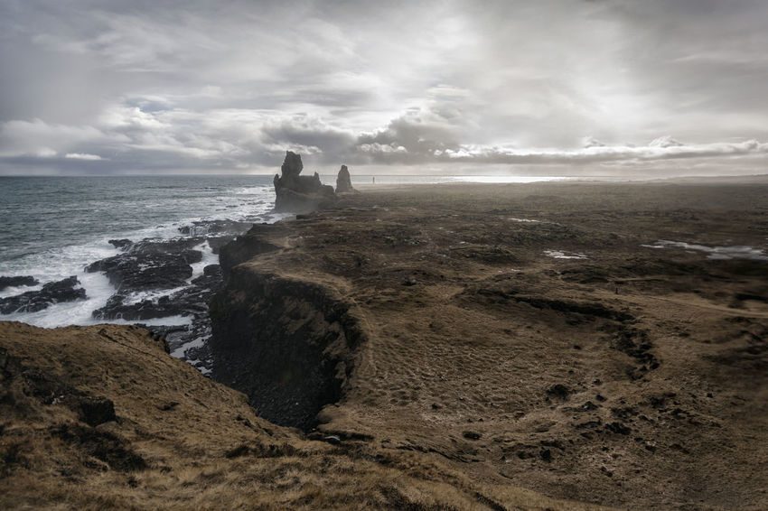 Landscape in Iceland Beauty In Nature Calm Cloud Cloud - Sky Cloudy Coastline Day Horizon Over Water Idyllic Nature Outdoors Remote Rock - Object Rock Formation Scenics Sea Seascape Shore Sky Tourism Tranquil Scene Tranquility Travel Destinations Vacations Water