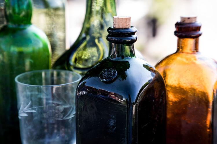 Close-up of beer glass bottles