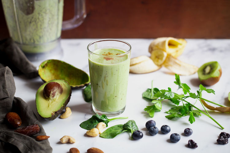 Green smoothie Food And Drink Healthy Eating Food Fruit Freshness Wellbeing Indoors  Green Color No People Smoothie Green Smoothie Avocado Blueberries Breakfast Superfood Spinach Almonds Nuts Vegetables Glass