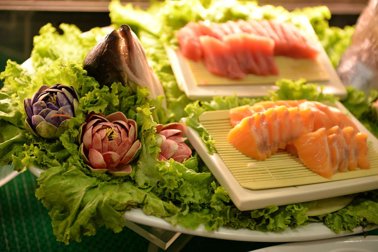 Close-up of sushi with vegetables served in plate
