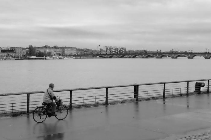 Mr Bicycle Water Sky River Transportation Outdoors Built Structure Building Exterior Waterfront Architecture Mode Of Transport City Bicycle Real People Full Length Bridge - Man Made Structure Nature Day Cloud - Sky Nautical Vessel One Person Eye4photography  Beautiful EyeEmBestPics EyeEm Best Shots Horizon Over Water