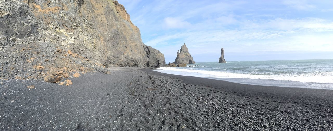 Panorama of the black sand beaches in Iceland EyeEm Selects Sea Nature Beach Beauty In Nature Rock Formation Scenics Rock - Object Tranquility Horizon Over Water Iceland Physical Geography Black Beach Outdoors EyeEm Selects Pebble Beach Vík í Mýrdal Vik Iceland Vik Beach Panoramic Photography Panorama Panoramic Landscape Panoramic View Panoramic Panorama View