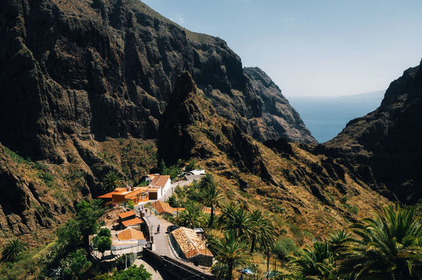 Masca Village on the rock in Tenerife, Canary Islands, Spain. Landmark Canary Islands Architecture Beauty In Nature Building Exterior Clear Sky Day Masca Mountain Nature No People Ocean Outdoors Rock - Object Rocky Mountains Scenics Tenerife Village View