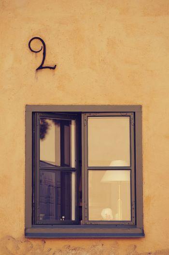 Window on yellow building