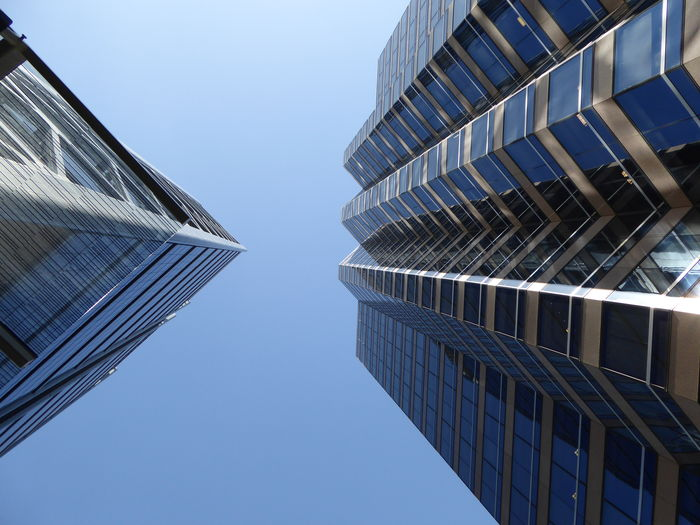 Architecture Building Exterior Built Structure Business Business Finance And Industry City Cloud - Sky Day Directly Below Low Angle View Modern Modern Architecture No People Office Block Office Building Exterior Outdoors Sky Skyscraper Straight Up! Twin Two Towers